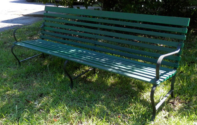 streets park bench wood slats cast iron green blue