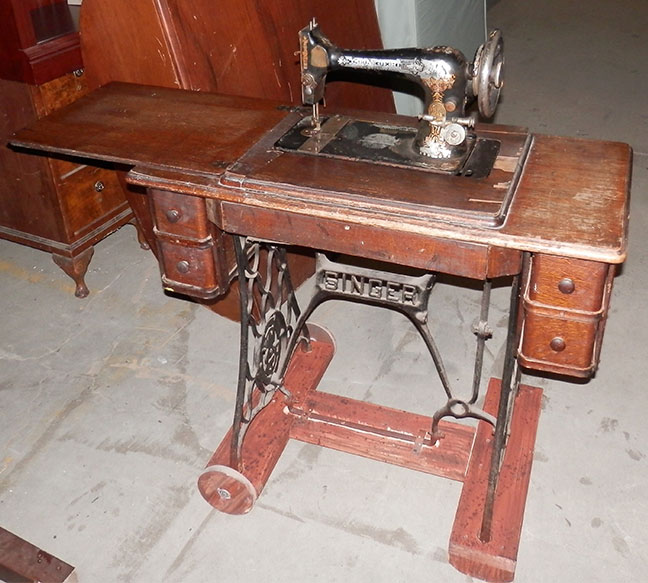 Pajama Game singer antique sewing machine on desk