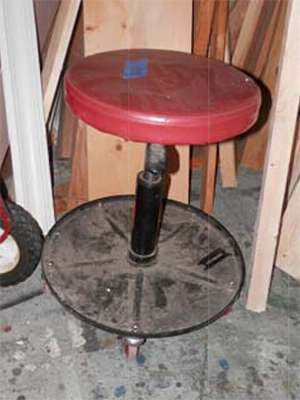 stool red seat wheels
