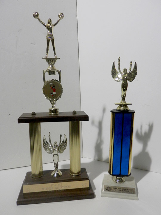 cheerleading and blue trophy