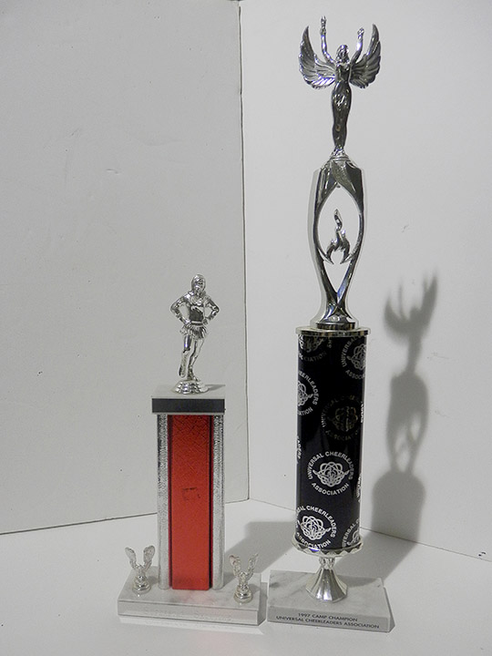 universal cheerleading association trophy black red