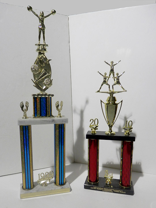 1999 blue 2010 red cheerleading trophy
