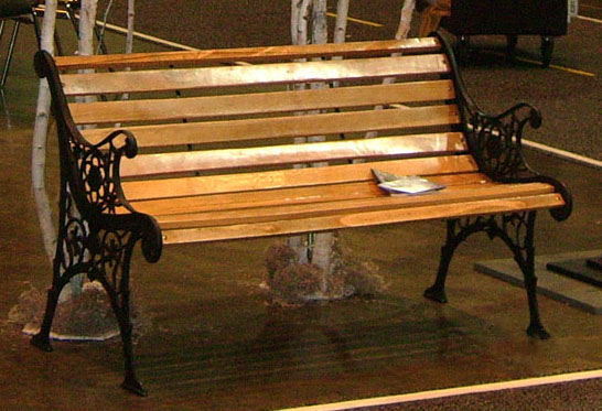 park bench wood city streets cast iron sides