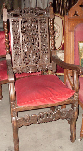 throne ornate carved wood red cushion