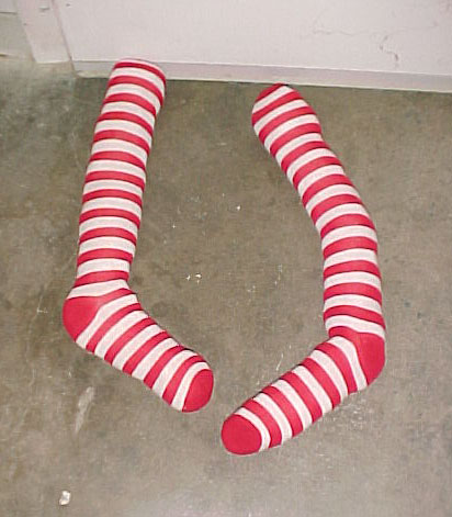 Wizard of Oz stocking legs wicked witch of the east under house red striped