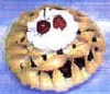 Fake fruit pie with lattice crust and dollop of frostingcream-pie.jpg
