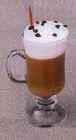 Fake mug of irish coffee, with whipped cream, straw